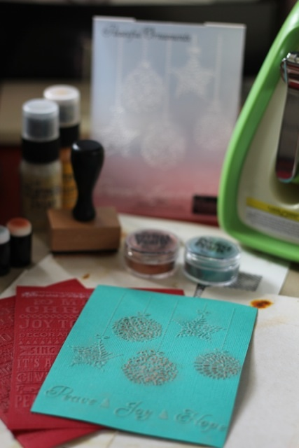 Two Christmas cards using Couture Creations embossing folders